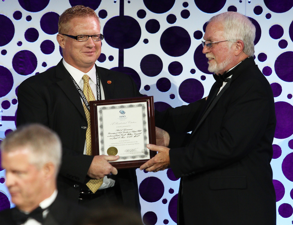 Kirk Boone accepts a Presidential Citation from IAAO