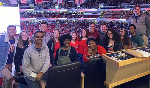 A group photo of the fellows at the Carolina Hurricanes hockey game
