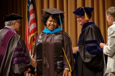 UNC MPA Student in Graduation Robes at Commencement Ceremony