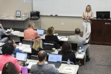 Shannon Tufts teaches a full classroom of professions at the Knapp-Sanders building in 2019.