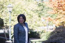 Anita Brown-Graham stands in front of fall foliage on campus at UNC-Chapel Hill in 2019.