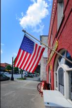 An American flag flies outside a red brick building in downtown Kinston, North Carolina