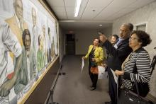 ACRED visits SERVICE mural