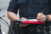 Law enforcement officer writes a ticket