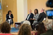 Panelists discuss a topic at a town hall meeting in Shelby, North Carolina.